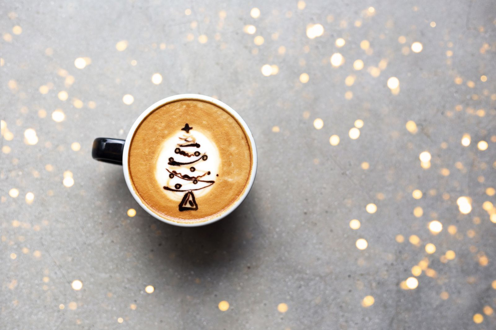 Image of a Holiday themed latte with a Christmas Tree Design