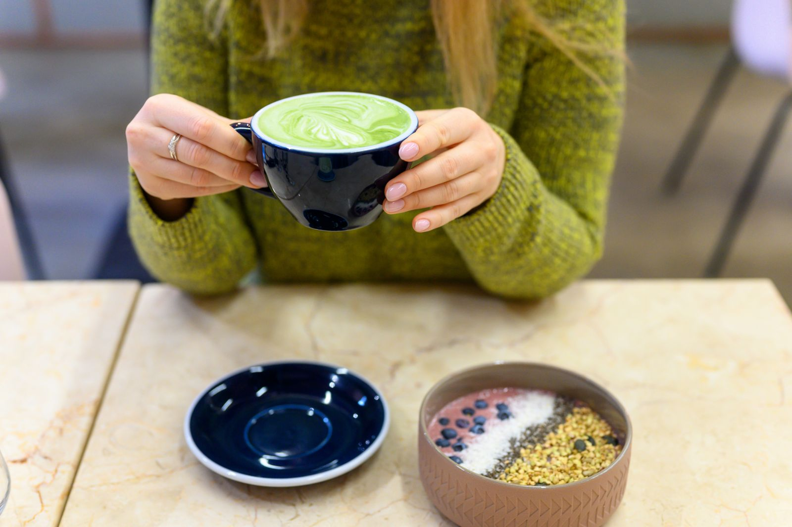 Person holding a Matcha latte